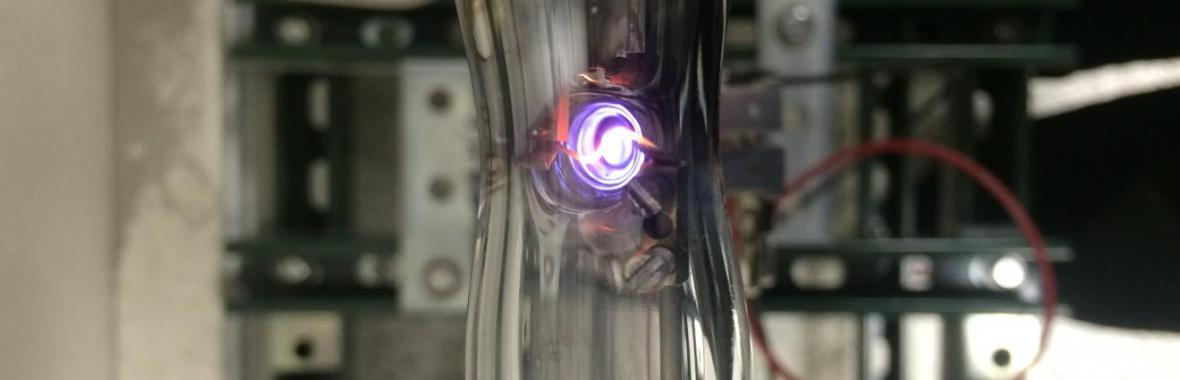 Hot-wire evaporation of gold with argon plasma; gold particles are generated by applying a current through the gold plated wire, where they then flow through an argon plasma chamber to catalyze silicon nanoparticle growth.